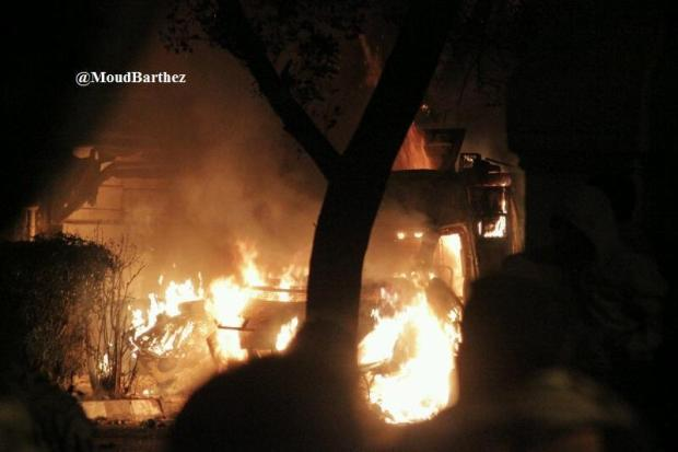 One of the two CSF APC trucks hijacked and torched by protesters [Credit in photo]