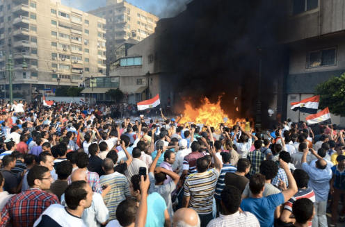 Protesters in Alexandria set fire to the Muslim Brotherhood's headquarters.