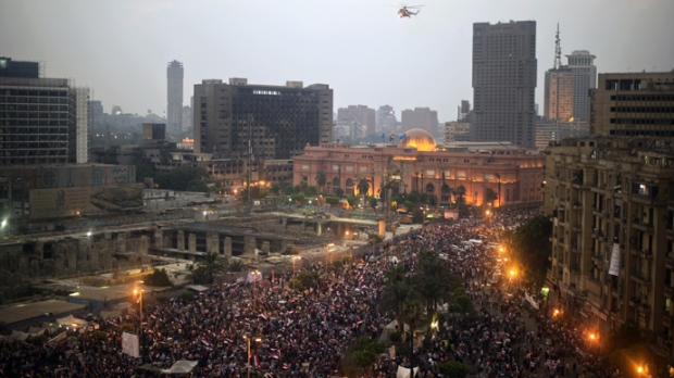 An Egyptian Military helicopter flies over protesters in Tahrir Square earlier today.