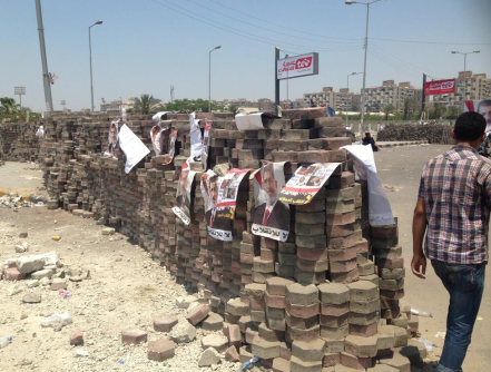 "Morsi supporters built a wall to ""defend against attacks."""