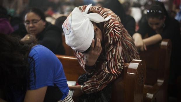 An Egyptian Coptic Christian woman prays in a church within Al-Mahraq Monastery in Assiut, Upper Egypt, Aug. 6, 2013. Photo: AP