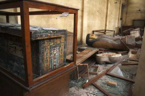 Damaged antiquities remain in the rubble of Mallawi National Museum