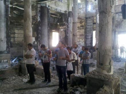 Coptic Pope Tawadros II shared this chilling image of Coptic Christians praying in a burned church