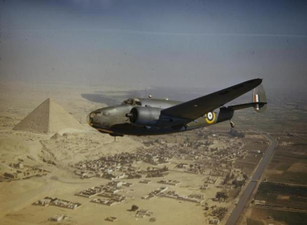 A military plane flies over the Pyramids in 1942