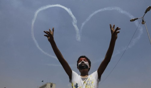 Military jets draw hearts in the sky over Tahrir Square in 2013. (Credit: AP/Amr Nabil)