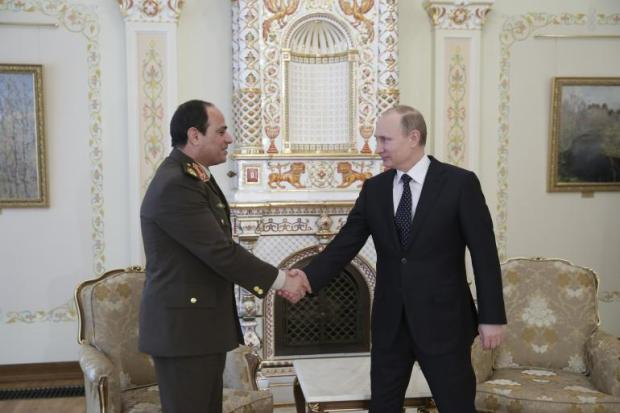 Military Chief Al-Sisi shakes hands with Russia's Putin in a visit to Moscow to discuss a historic arms deal.
