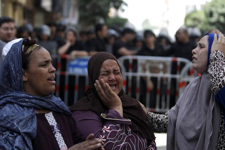 Relatives and families of members of the Muslim Brotherhood and supporters of ousted President Mohamed Mursi react in front of the court in Minya, south of Cairo, after hearing the sentence handed to Muslim Brotherhood leader Mohamed Badie and other Brotherhood supporters April 28, 2014. An Egyptian court handed down a death sentence to Badie, the Brotherhood's general guide, and 682 supporters, intensifying a crackdown on the movement that could trigger protests and political violence ahead of an election next month. REUTERS/Mohamed Abd El Ghany