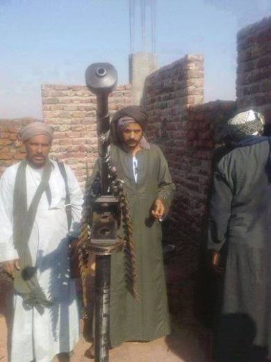 Photographs of tribesmen posing with heavy weaponry have been circulated on social media